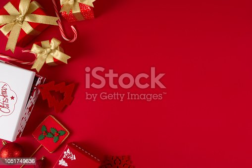 Christmas gift boxes on red background with copy space