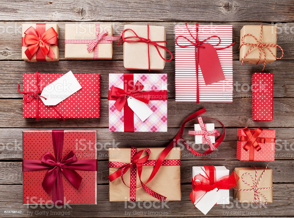 Christmas gift boxes Christmas or valentines day gift boxes on wooden table. Top view Above Stock Photo