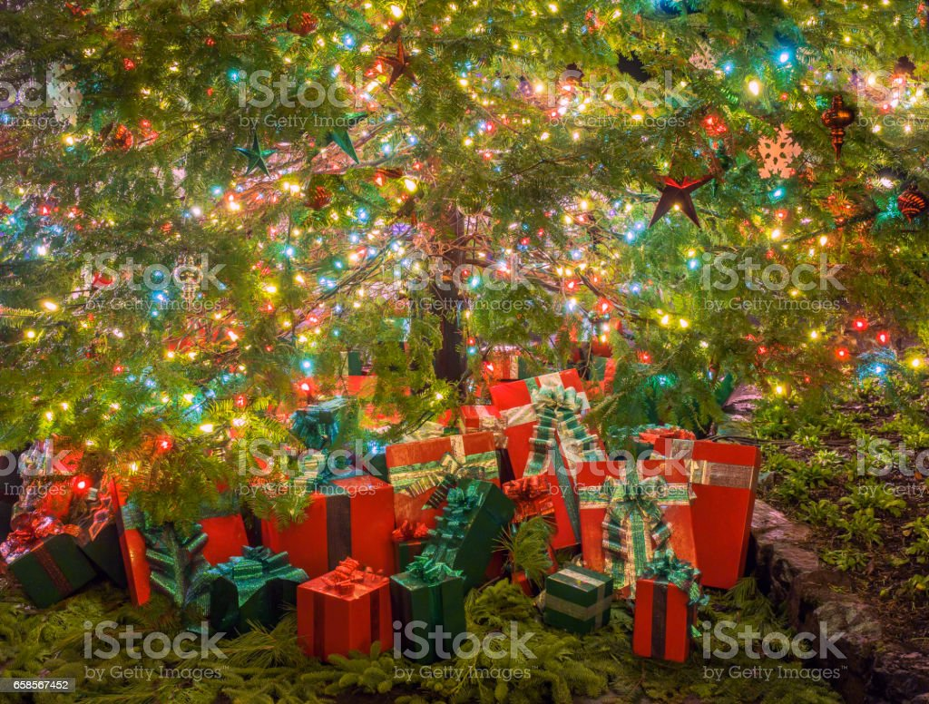 Christmas Gift Boxes Stacked Under The Decorated Tree Stock Download Image Now