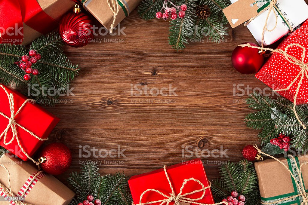 Christmas Gift Boxes with Baubles and Fir Tree Branch stock photo