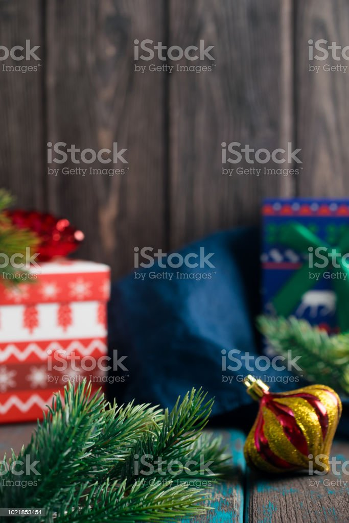 Christmas gift boxes with toys and fir branches. stock photo