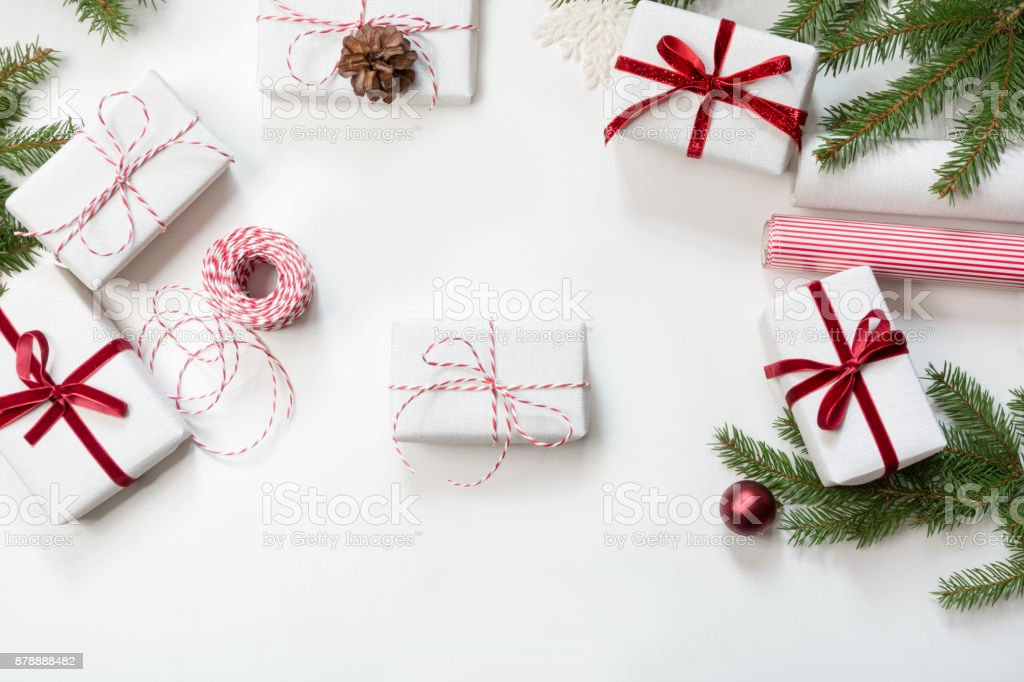 Christmas Gift Boxes Wrapped In White Craft Paper And Decorative Red