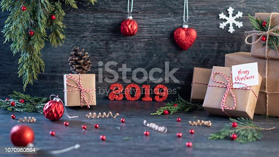 istock Christmas gift boxess on background with new year wishes 2019 1070980864