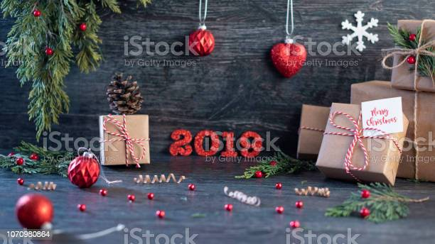 Christmas gift boxess on background with new year wishes 2019