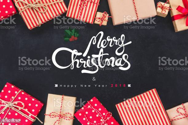 Christmas gift boxess on black background with new year wishes 2018 picture id876018782?b=1&k=6&m=876018782&s=612x612&h=yg3 7obhvsp9tmzg6rafni5t95bkex5xzrojxxbkt3e=