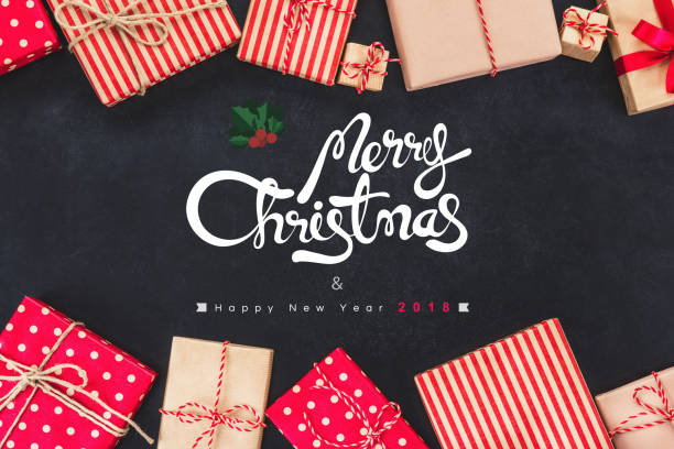 christmas gift boxess on black background with new year wishes 2018 - wrapping paper stock photos and pictures