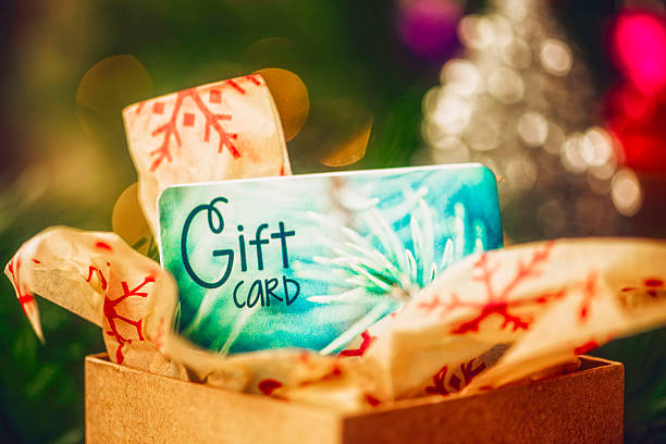 Christmas gift card in opened box in Christmas setting Christmas gift card in opened box in Christmas setting gift card stock pictures, royalty-free photos & images