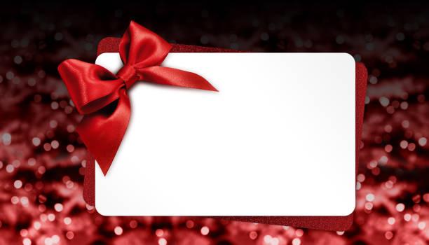 weihnachts-geschenk-karte mit roter schleife auf unscharfen lichter der vorlage textfreiraum - partylabels stock-fotos und bilder