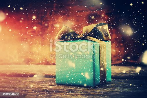 493890050istockphoto Christmas Gift. Festive Box with Drawn Snow 493884672