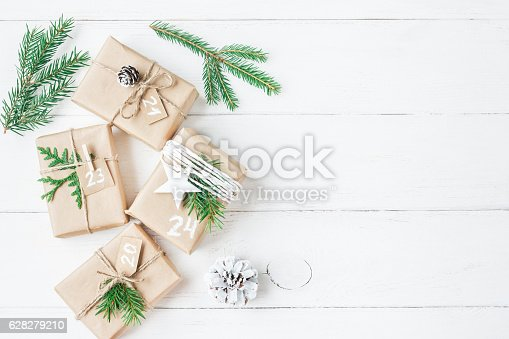istock Christmas gift, fir branches, pine cones. Flat lay, top view 628279210