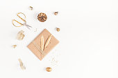 istock Christmas gift, golden decorations on white background. Flat lay 873261246