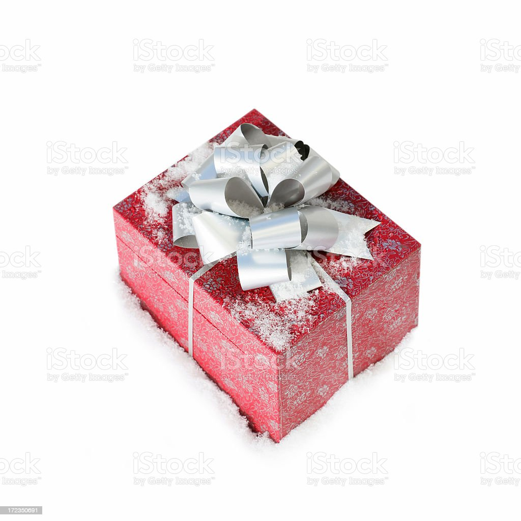 Christmas gift in a snow (isolated) royalty-free stock photo
