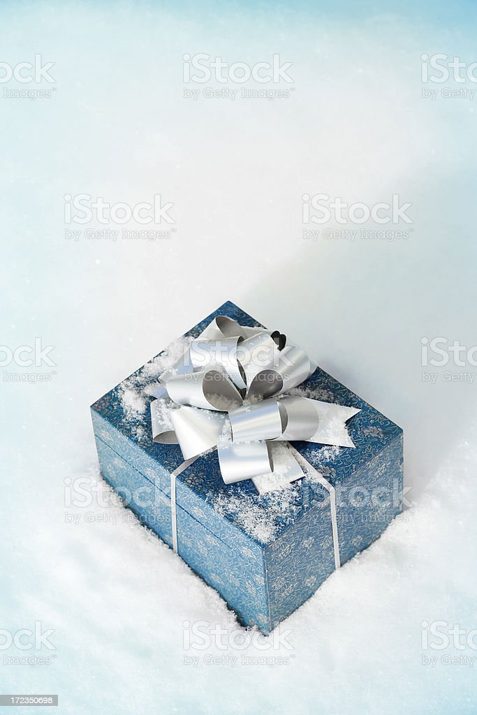 Christmas gift in a snow royalty-free stock photo