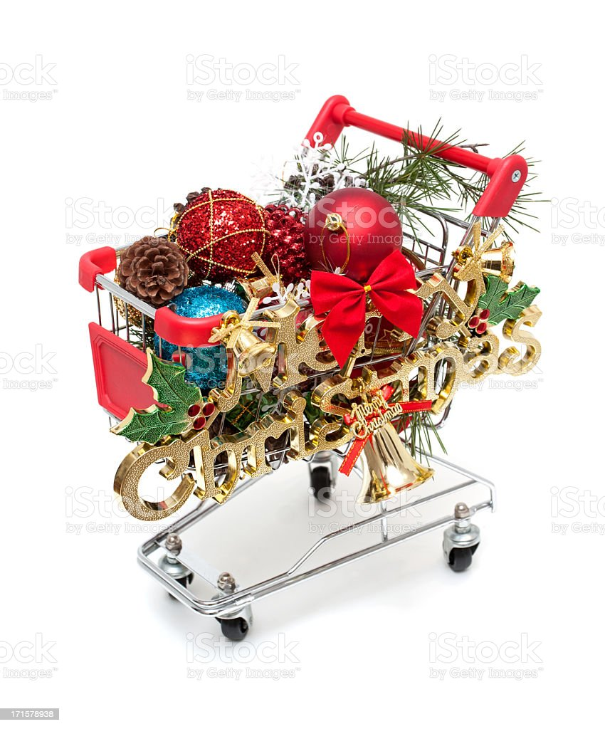 Christmas gift in shopping cart isolated on white background royalty-free stock photo