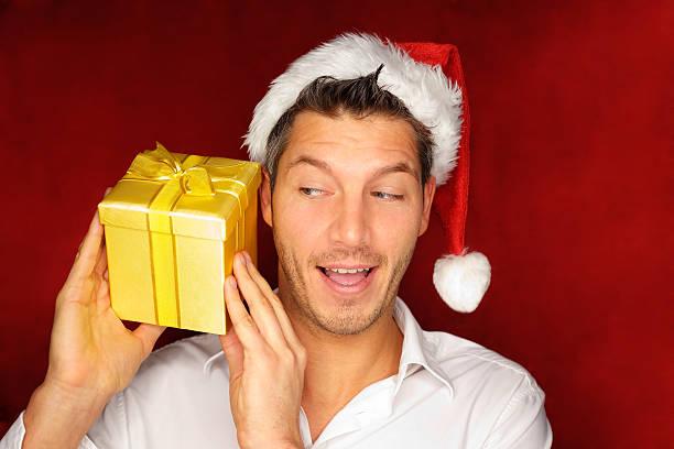 christmas gift man stock photo