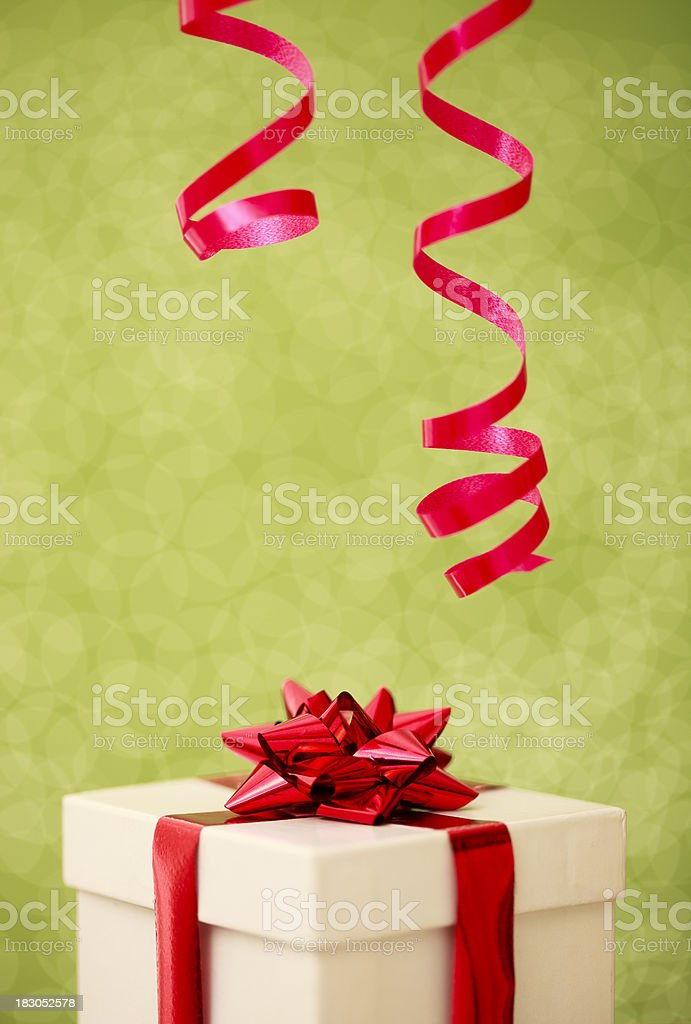 Christmas gift on a green defocused background royalty-free stock photo