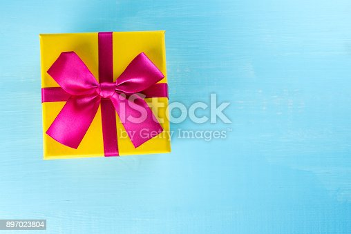 istock Christmas gift, on blue background. Flat lay, top view, copy space. Happy new year 897023804