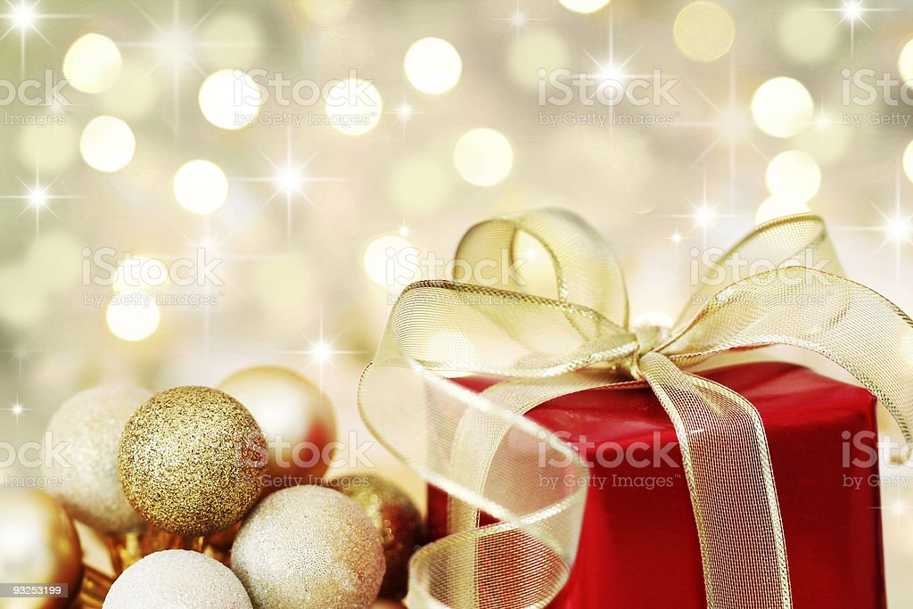 Christmas gift on defocused lights background stock photo