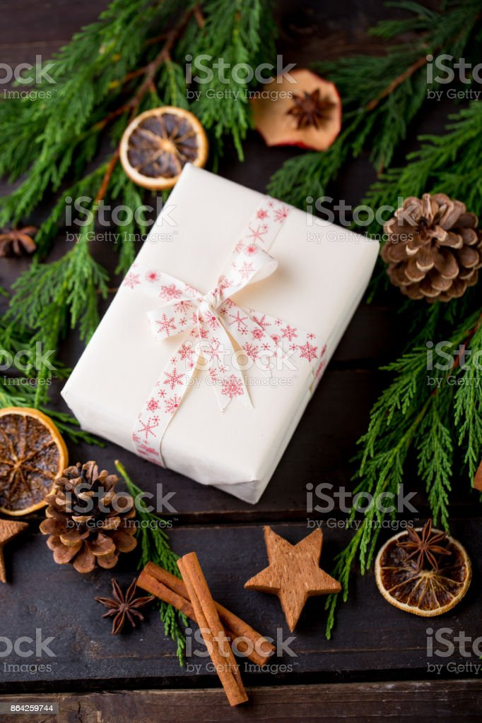 Christmas gift on the antique wooden background. royalty-free stock photo
