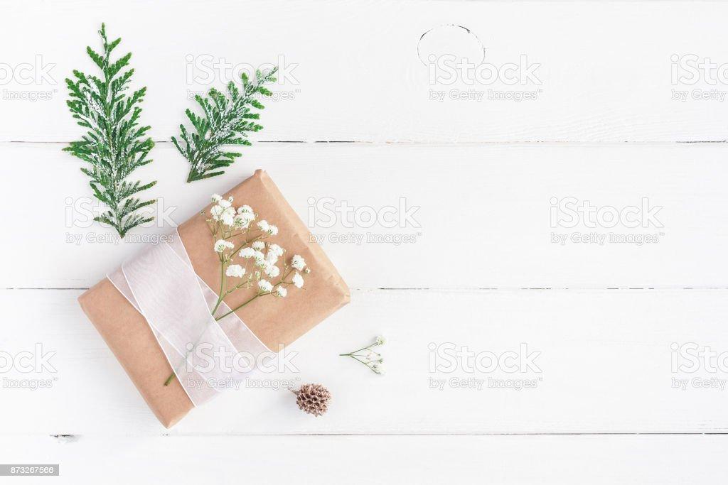 Christmas border. Christmas gift, pine cone, gypsophila flowers,...