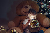 Little girl with opens Christmas gift