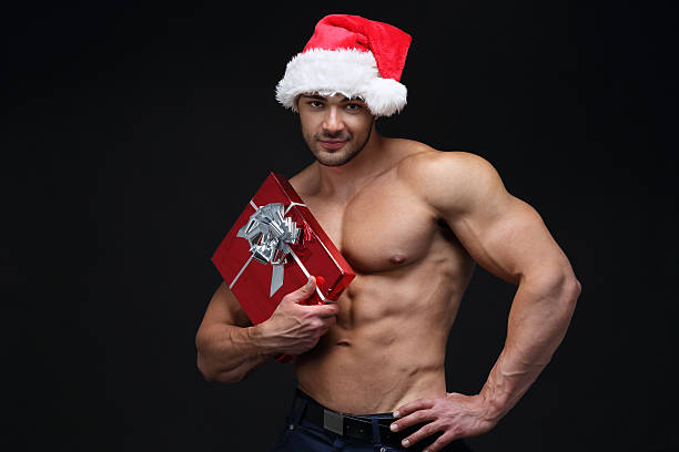 christmas gift - naked santa claus stock pictures, royalty-free photos & images