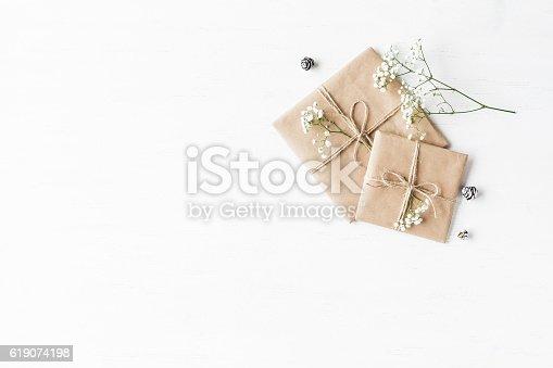 istock Christmas gift, pine cones and gypsophila flowers 619074198