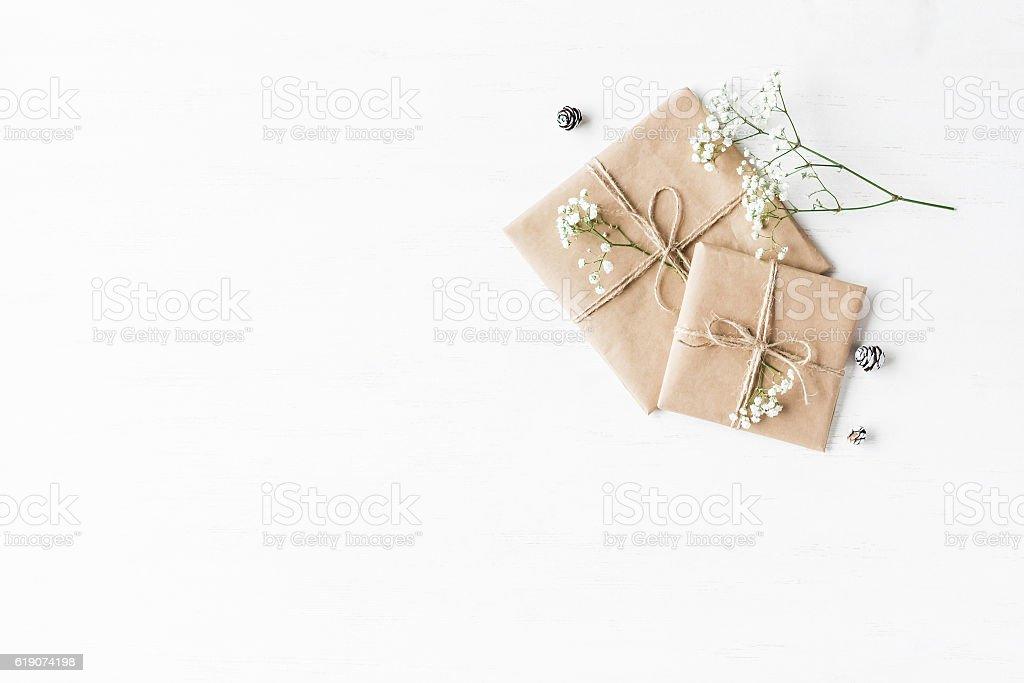 Christmas gift, pine cones and gypsophila flowers stock photo