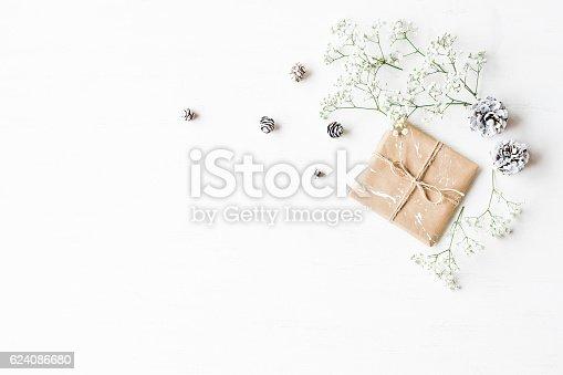 istock Christmas gift, pine cones and gypsophila flowers 624086680