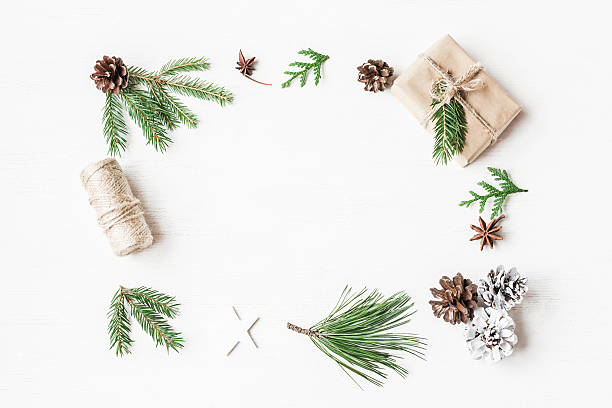 Christmas gift, pine cones, fir branches. Top view, flat lay - foto de stock