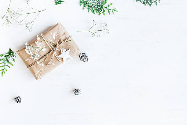 Christmas gift, pine cones, thuja branches and gypsophila flowers stock photo