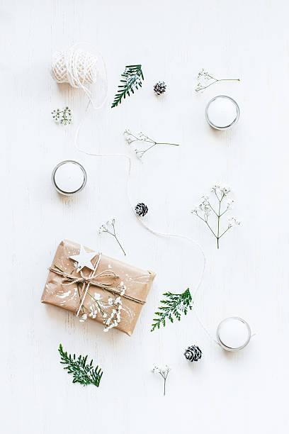 Christmas gift, pine cones, thuja branches and gypsophila flowers.Flat lay 스톡 사진