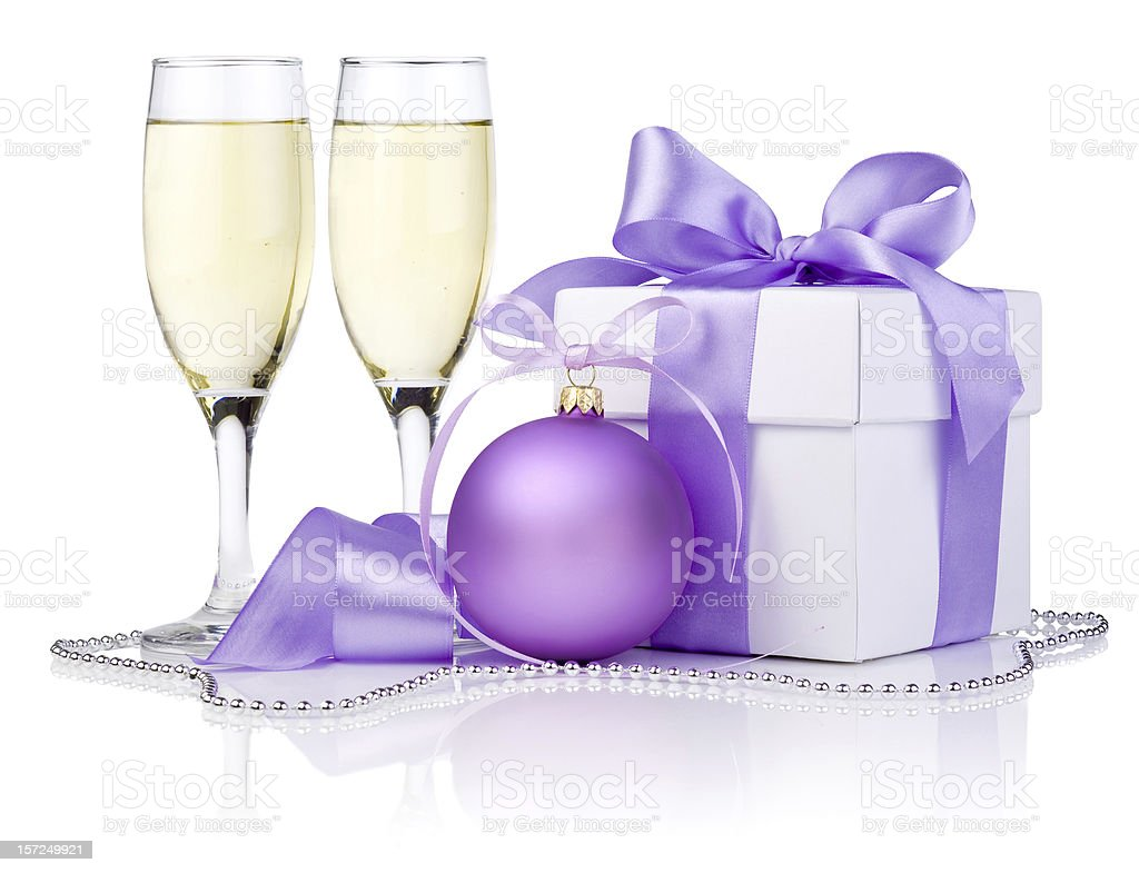 Christmas gift, Purple Ball, two champagne glass and ribbon bow royalty-free stock photo