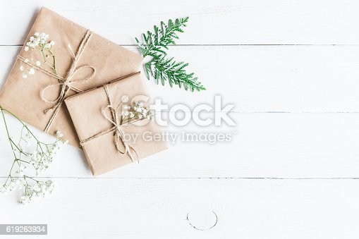 istock Christmas gift, thuja branches and gypsophila flowers 619263934