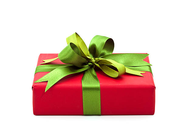 Christmas gift with a green bow stock photo