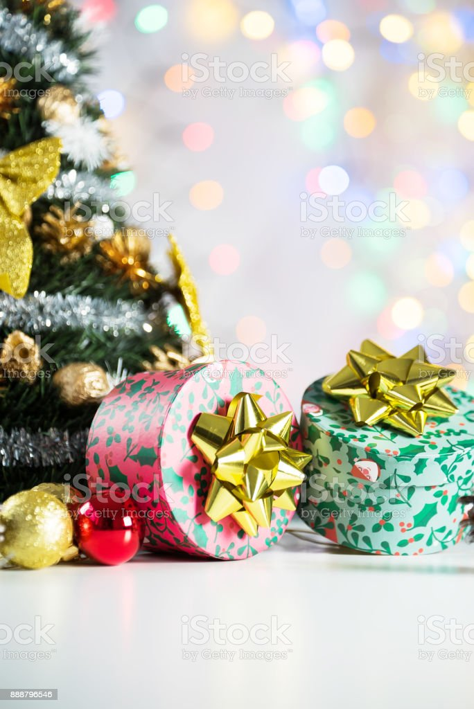 christmas gift with balls bow bright background. Studio shot stock photo