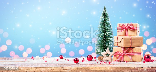 Christmas Present - Giftboxes And Christmas Tree With Ornament On Table
