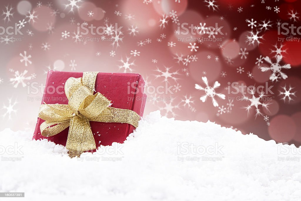 Christmas gift with red defocused lights background royalty-free stock photo