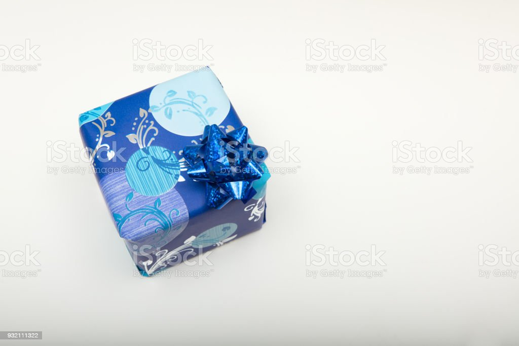 Christmas gift wrapped in decorative blue paper stock photo