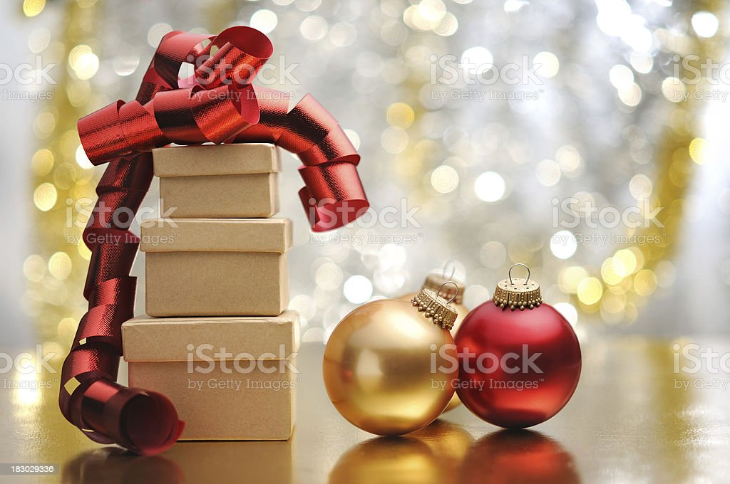 Christmas gifts and baubles with illuminated background stock photo