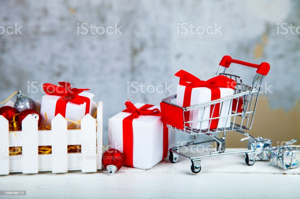 Christmas gifts and decorations in a white box on a grunge...