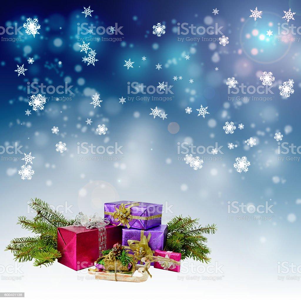 Christmas gifts and night snowfall. stock photo