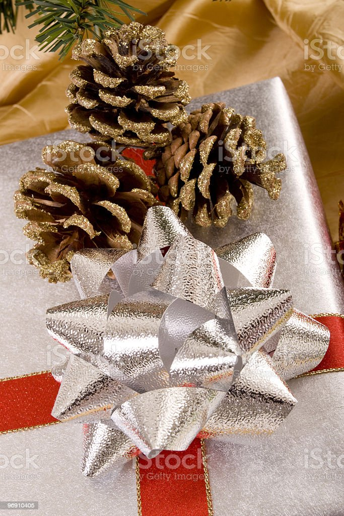 Christmas gifts and pine cones royalty-free stock photo