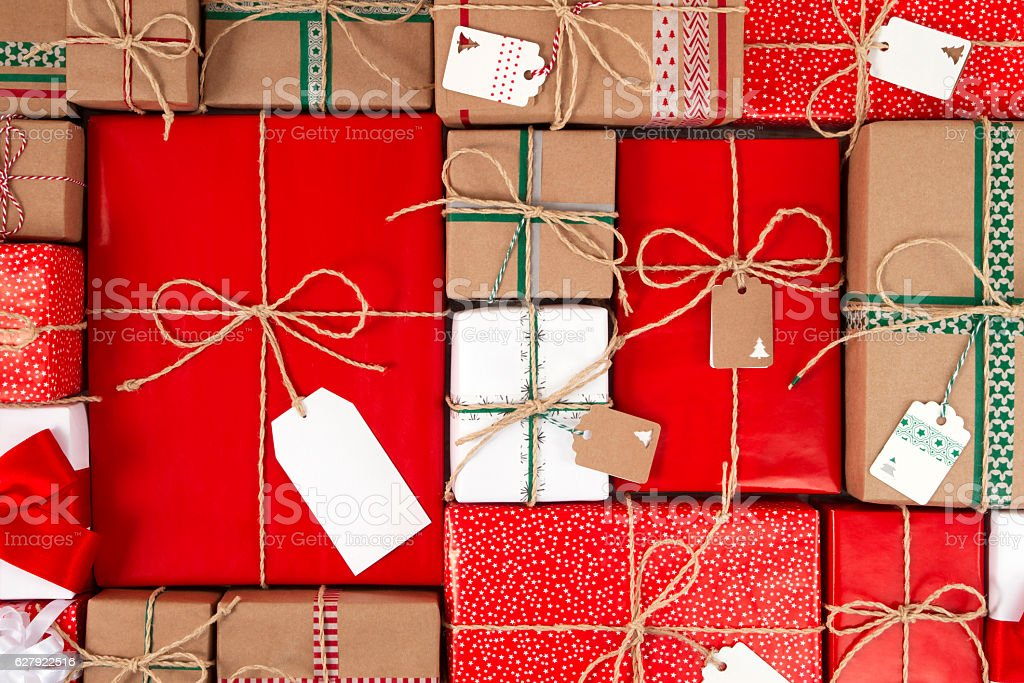 Christmas Gifts Boxes with Empty Tags Above view of Christmas gift boxes with empty gift tags. 2017 Stock Photo