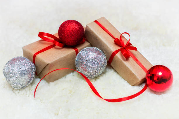 Christmas gifts, Christmas balls and festive ribbons on a colored background. holiday, cottage, New Year, Christmas, birthday stock photo