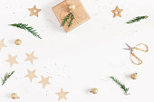 istock Christmas gifts, conifer branches, garland. Flat lay, top view 892666744