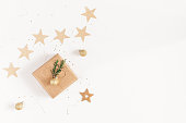 istock Christmas gifts, conifer branches, garland. Flat lay, top view 892671238