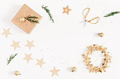 istock Christmas gifts, conifer branches, garland. Flat lay, top view 892712046