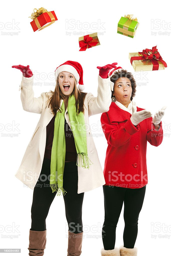 Christmas Gifts Falling into Hands of Happy Teen Girls royalty-free stock photo