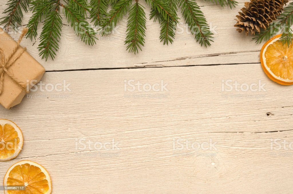 Christmas gifts, fir tree branches on white wooden table, background....